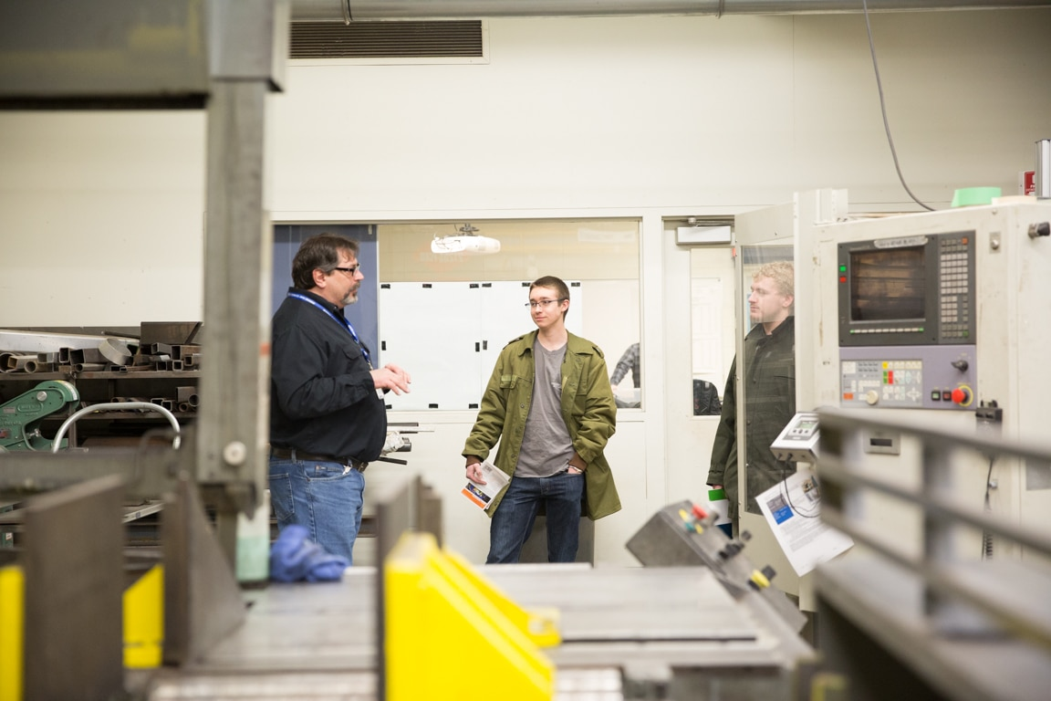 guests touring welding area at moraine park