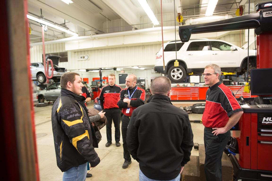 guests touring moraine park automotive lab at discover moraine park