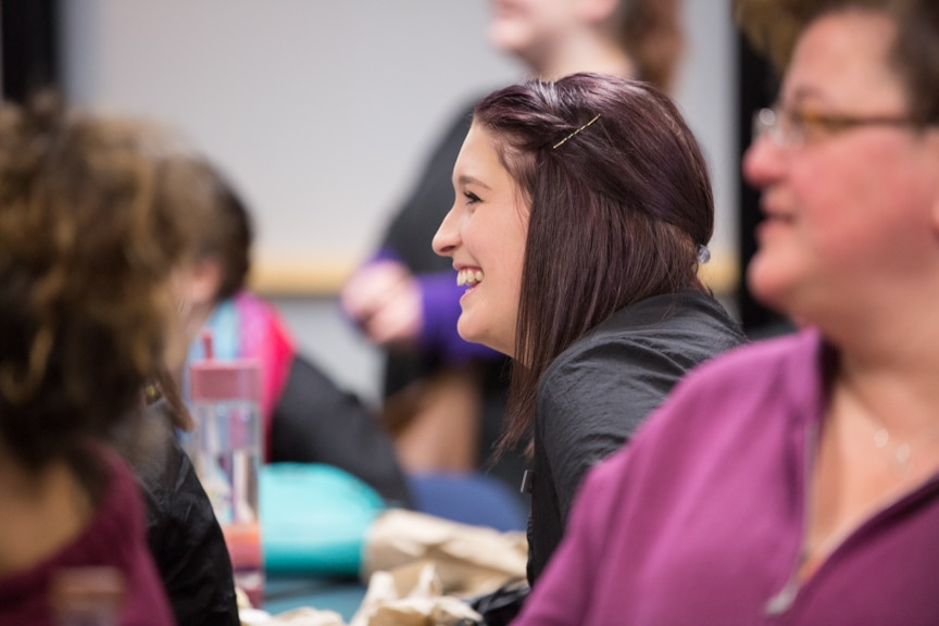 female student laughs during chris jones performance at moraine park