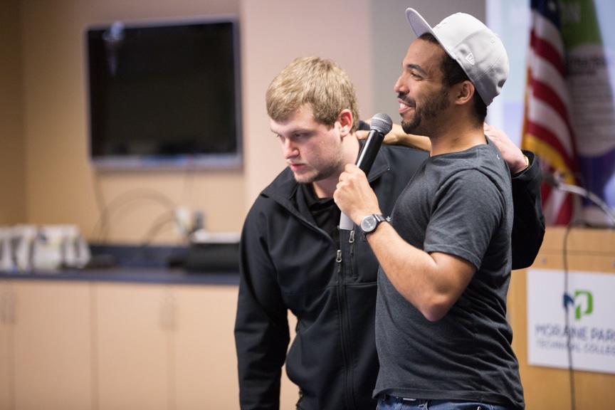 chris jones talks to crowd near hypnotized male student