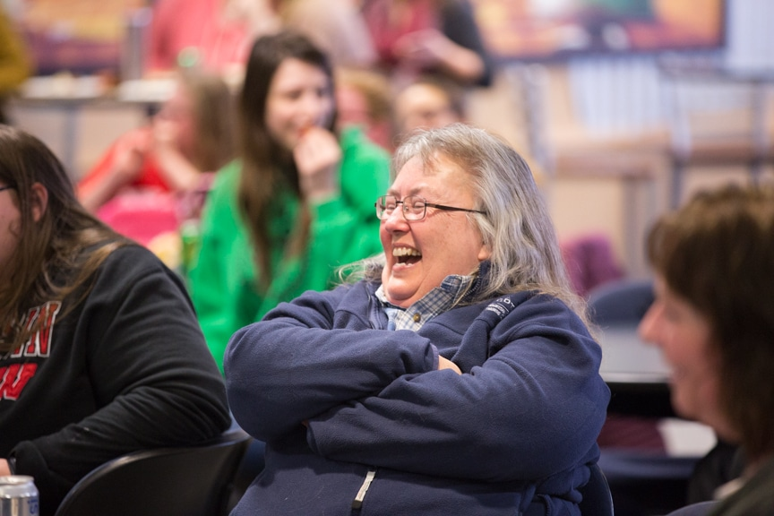 woman laughs in crowd during moraine park hypnotist show