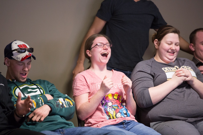 group of hypnotized students sit back in chairs