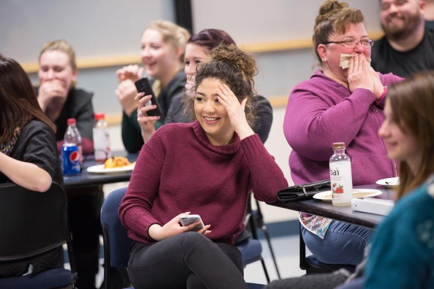 female student laughs during hypnotist chris jones show