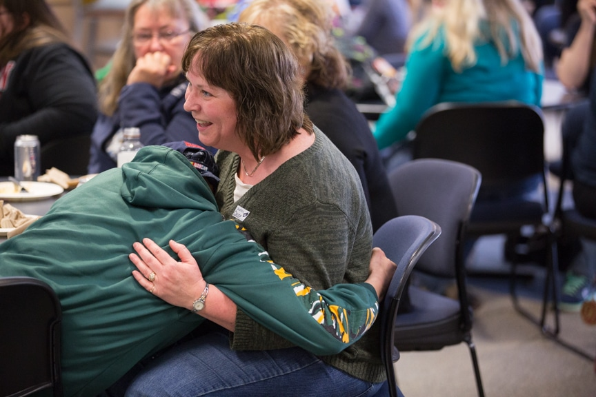 student hugs staff member during moraine park hypnotist show