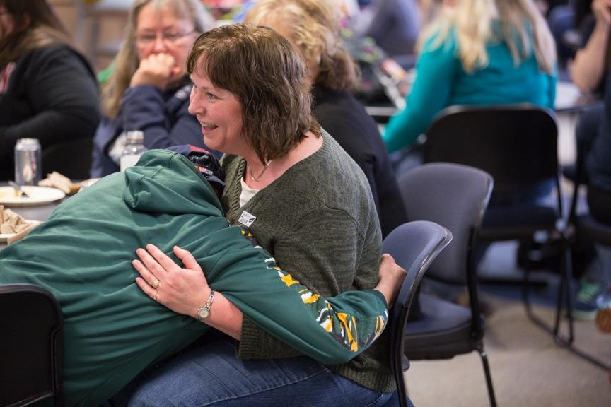student hugs staff member during moraine park hypnotist show