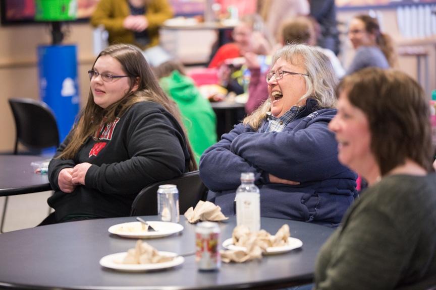 staff laughs during mptc hypnotist show