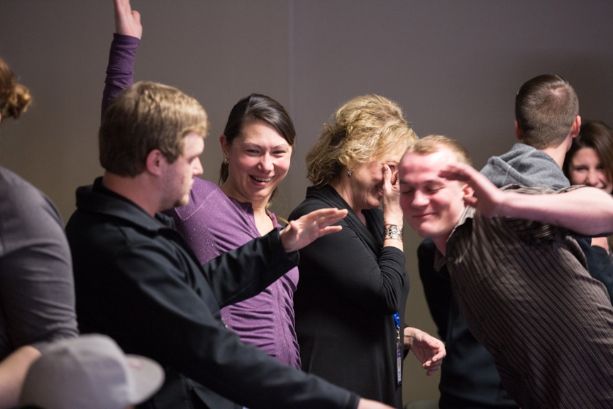 staff looks away as students do funny dance at moraine park hypnotist show