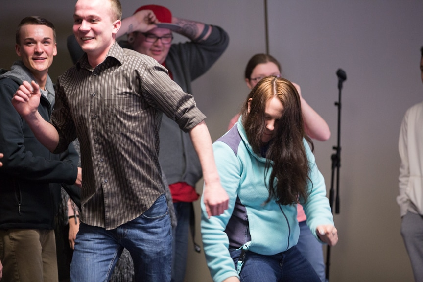 students dance during hypnotist show