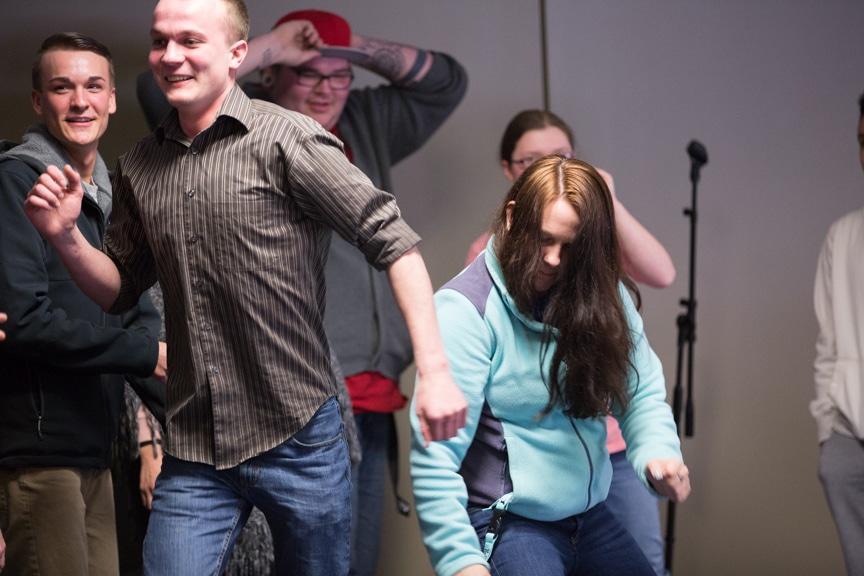 students dance during hypnotist show