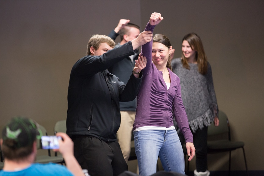 students dance together during chris jones hypnotist show at moraine park