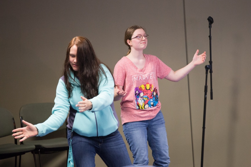 two female students dance during hypnotist show at moraine park