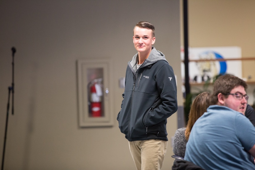 male student smiles during chris jones show at moraine park