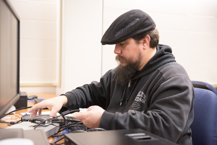male IT student works on computer repair project at Moraine Park