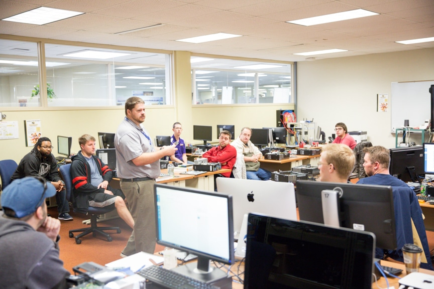 male instructor speaking to moraine park IT class