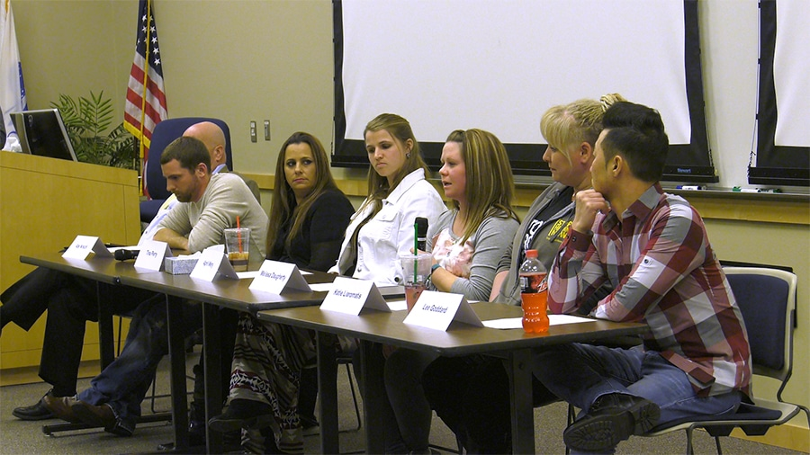 heroin panel at west bend campus sits at table