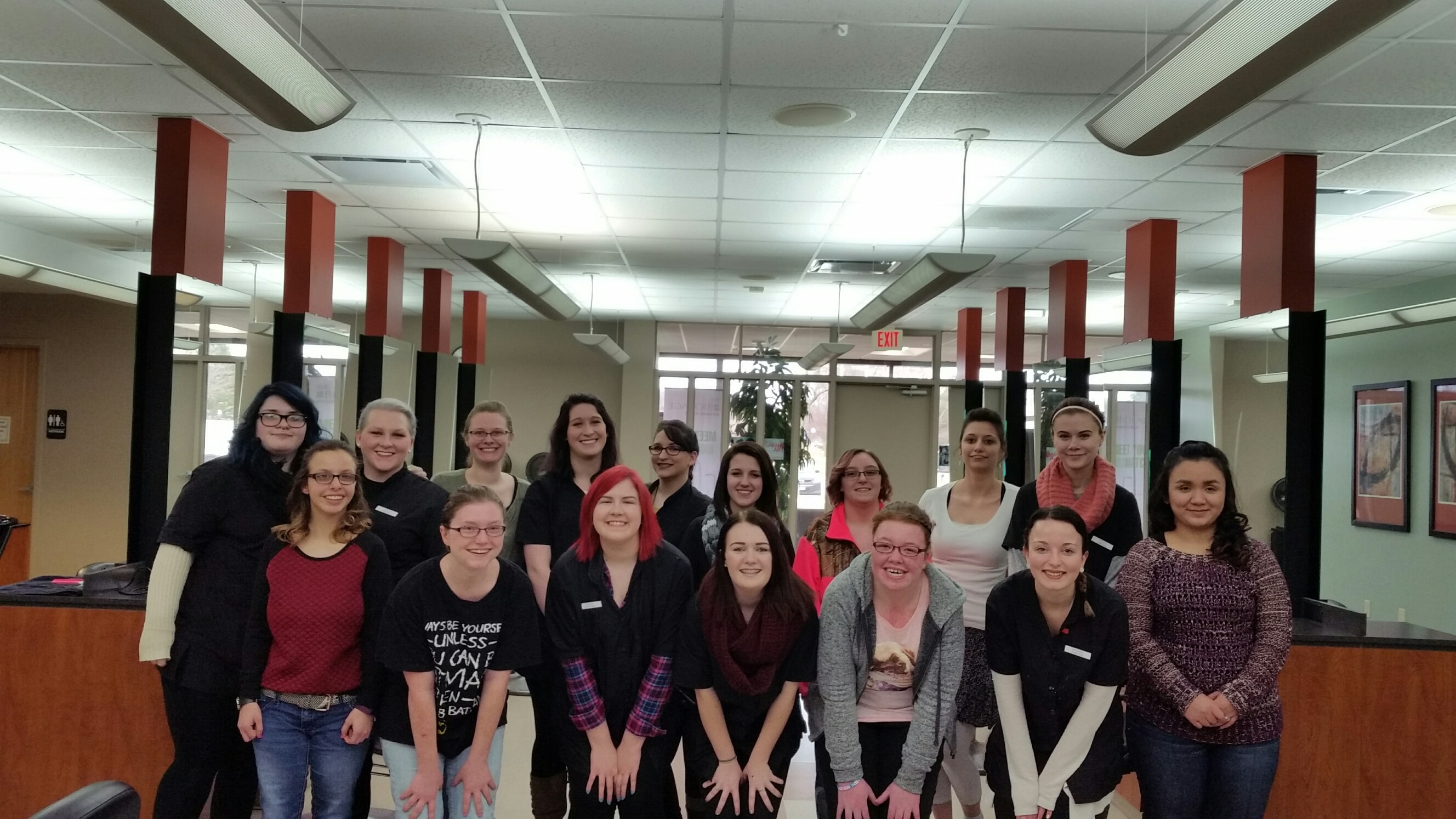 moraine park cosmetology students gather for group photo in salon