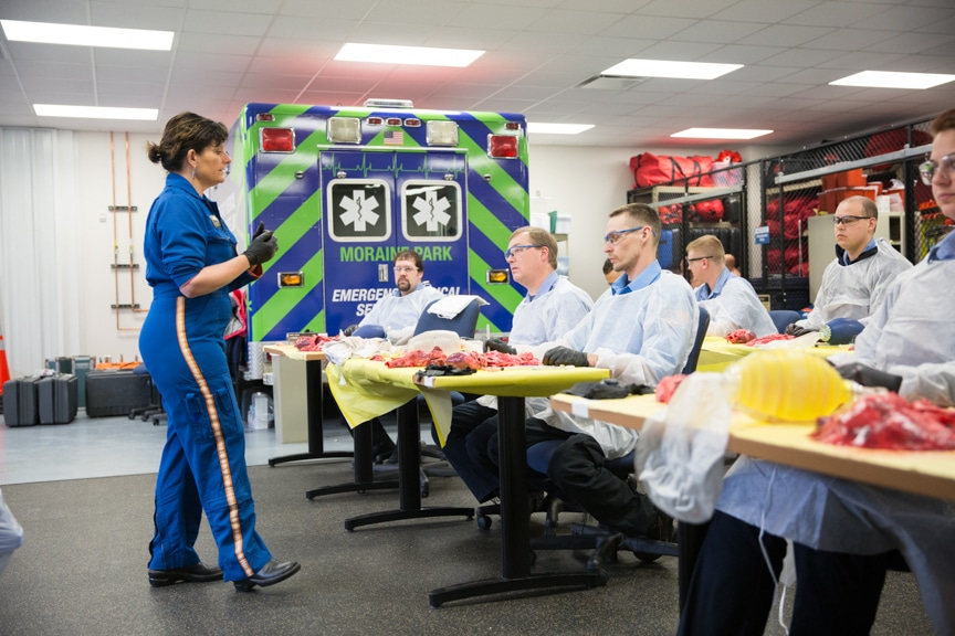female paramedic speaks to class of EMT students