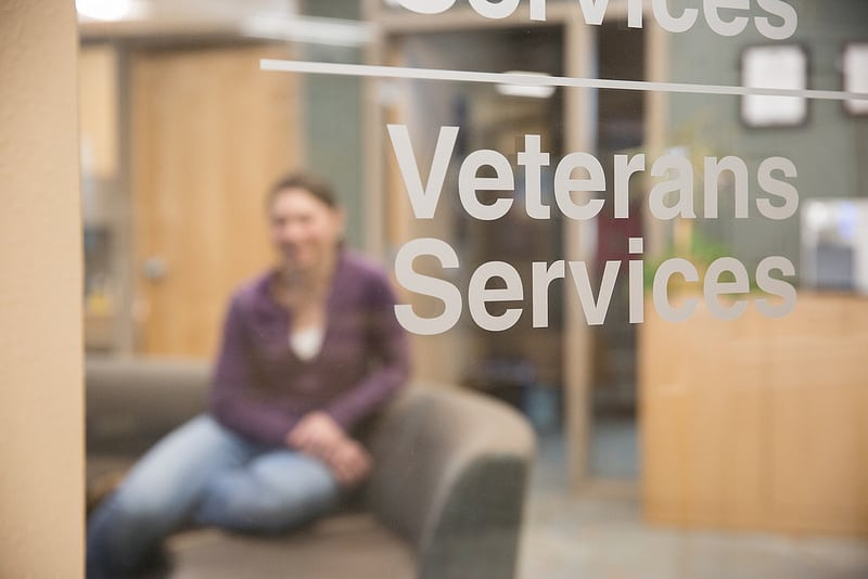 Moraine Park Veterans Services door with female veteran inside
