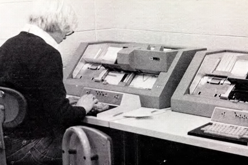 Vintage photo of Moraine Park student working on card punching machine