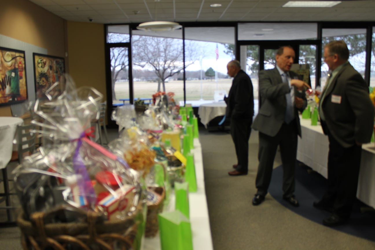 Tables of door prizes at MPACTE event