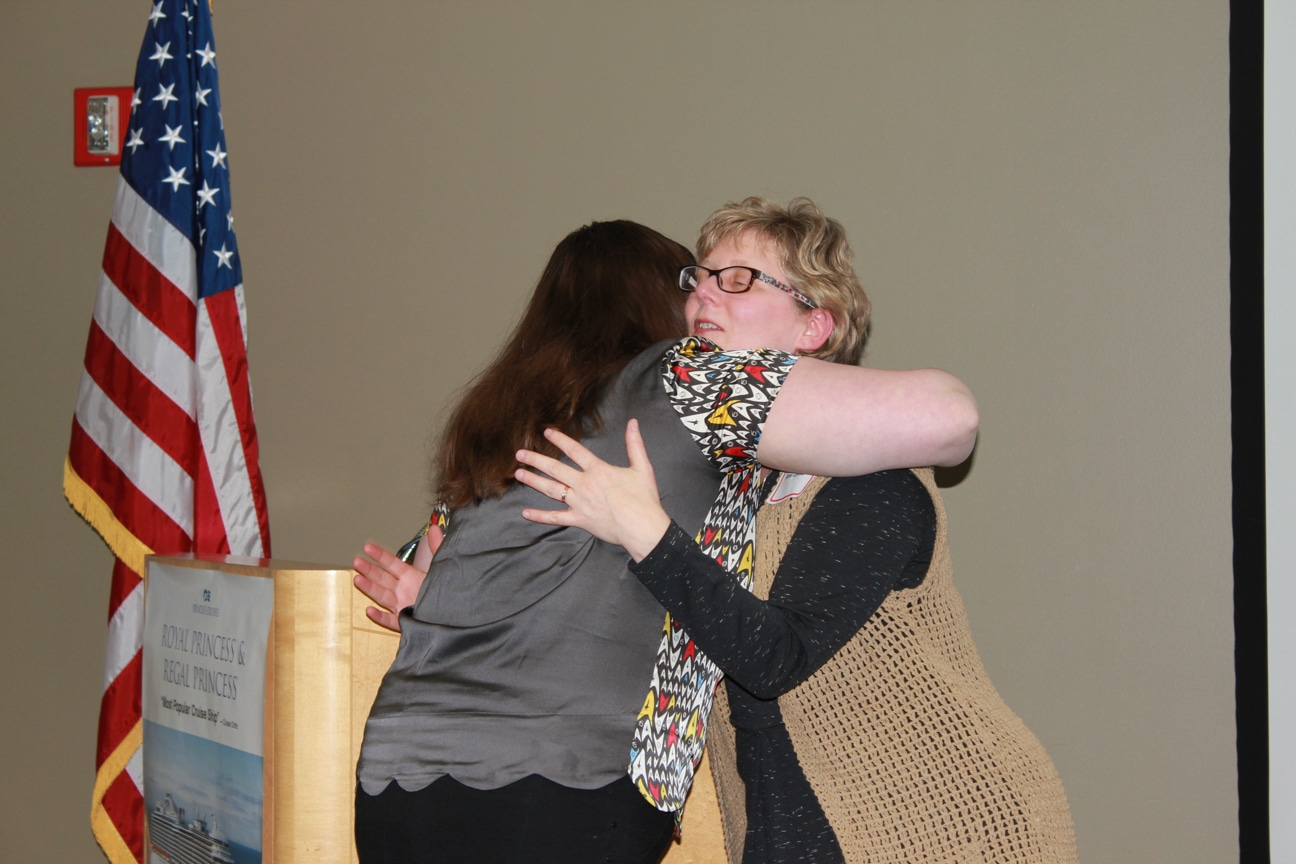 Moraine Park Katie Gindt & Anne Lemke hugging at Career & Tech Ed event