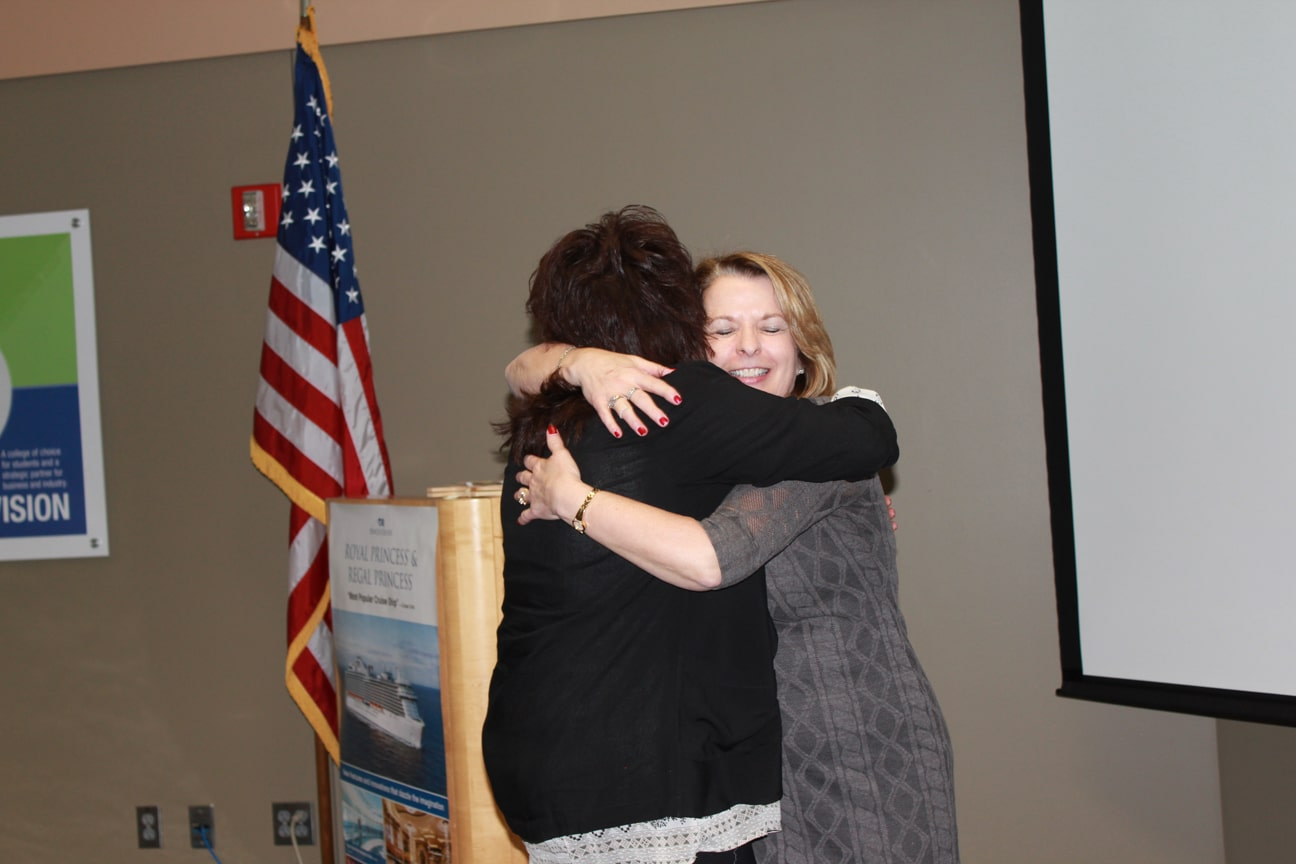 Julie Lotto & Bonnie Bauer hugging at Career & Tech Ed event