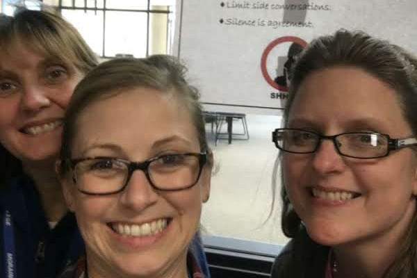 staff members smile during selfie
