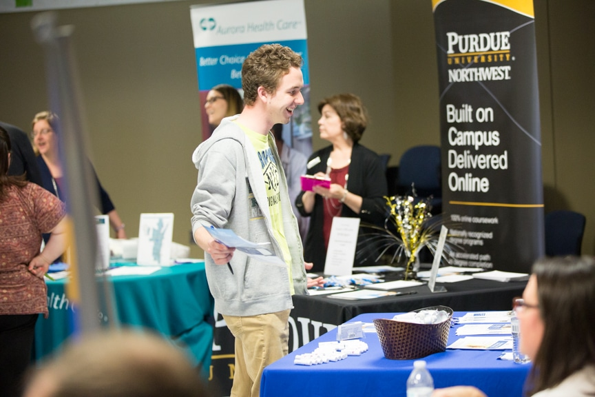 male student smiles during mptc healthcare career fair