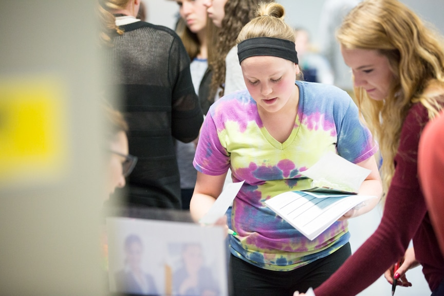 students gather around table at healthcare career fair