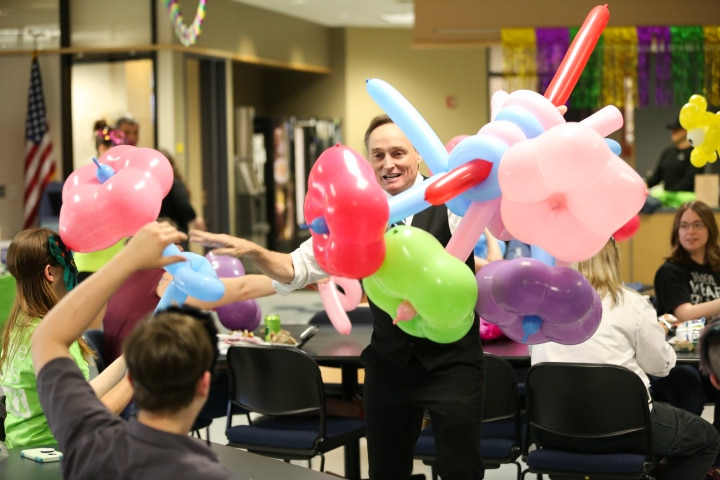 john cassidy hands out balloons at moraine park comedy performance