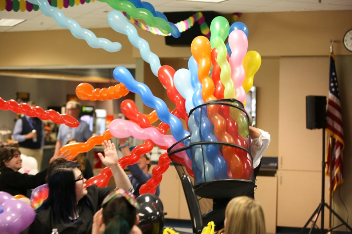 john cassidy hands out many balloons at moraine park comedy performance