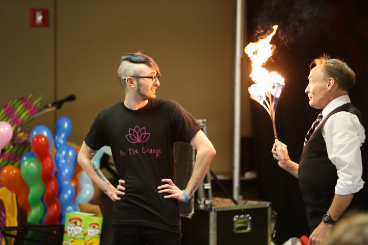 john cassidy holds flaming stick during moraine park show