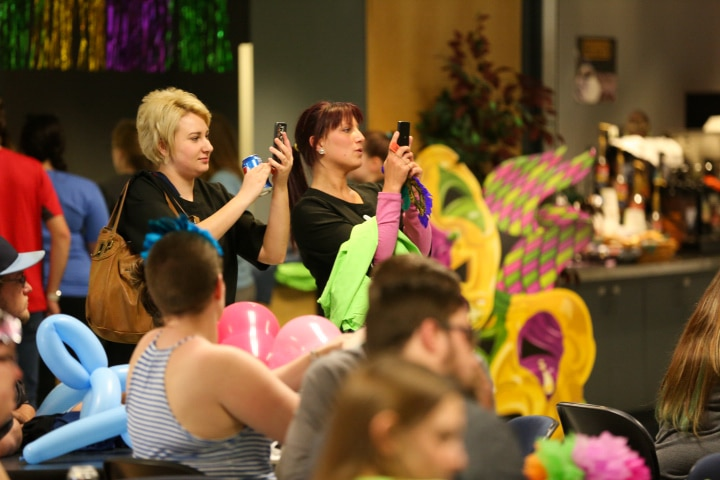 students hold phones up for photos during last blast performance at Moraine Park