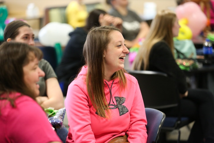 female student laughs during John Cassidy show at Moraine Park