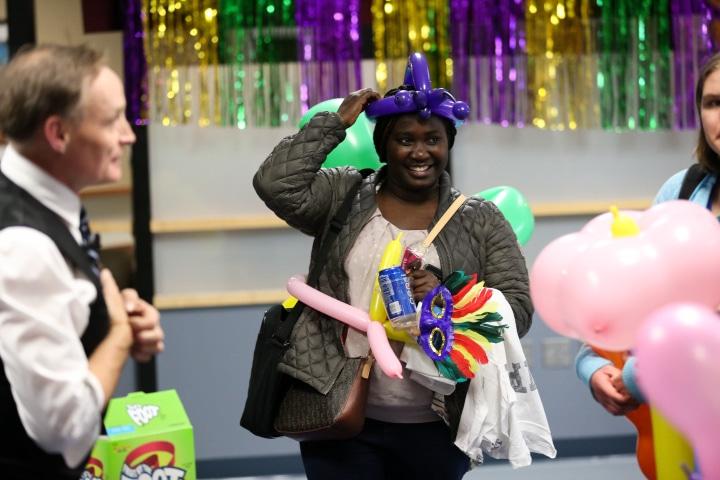 student wears balloon hat