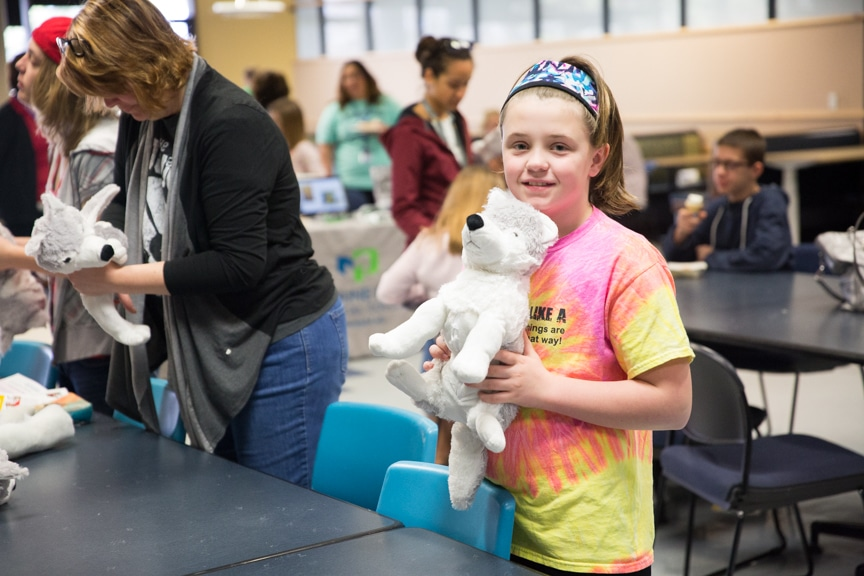 Girl with mascot wolf at Moraine Park Open House