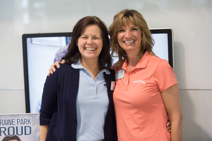 Dana Bourland, Foundation Director and Joan Brezinsky Alumni Specialist hugging