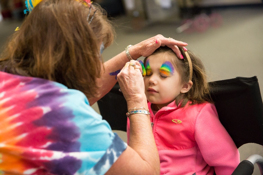 Little girl having her face painted at Moraine Park Open House