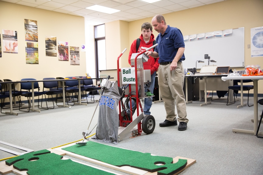 Math Instructor demonstrating golf game at Moraine Park Open House