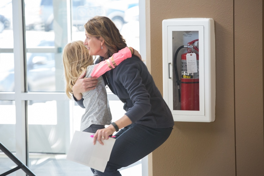 Administrative Asst. Melanie Petrowitz hugs her daughter at Moraine Park Open House