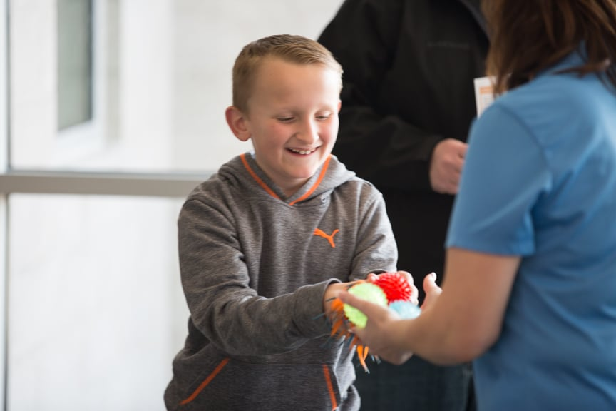 Boy received stress balls at Moraine Park Open House