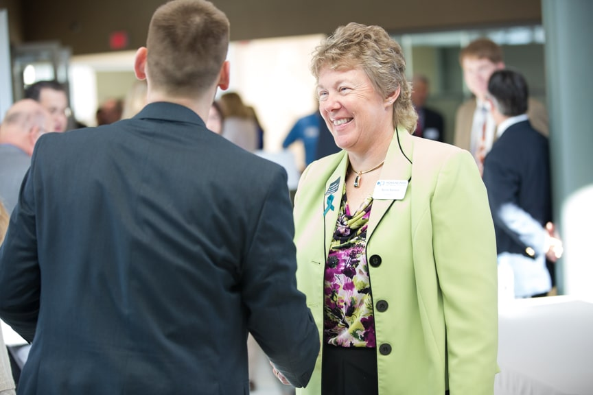 Bonnie Baerwald shaking hands with a man at Moraine Park Open House