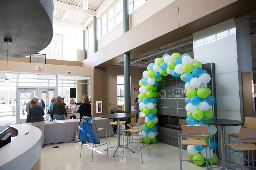 Moraine Park Open House balloon arch and fireplace