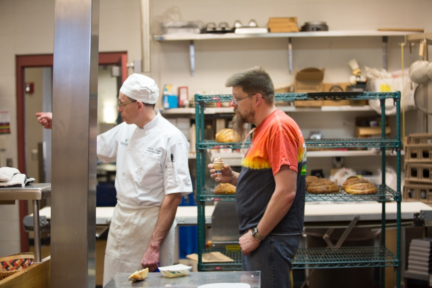 Moraine Park Open House Culinary instructor showing kitchen to man