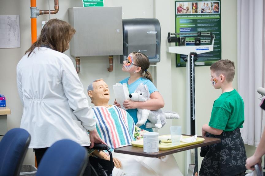 Two children exploring Nursing lab at Moraine Park Open House
