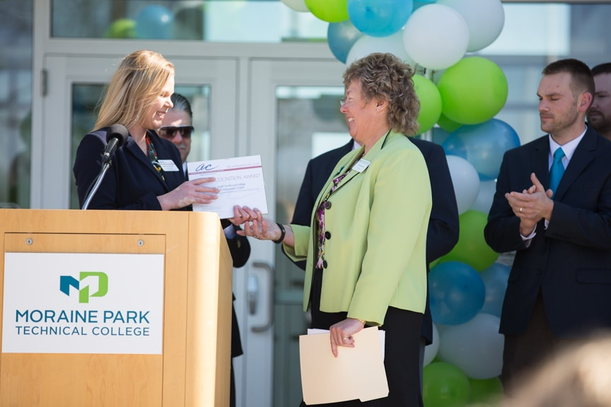 Asso. of Commerce hand Bonnie Baerwald a recognition at Moraine Park Open House
