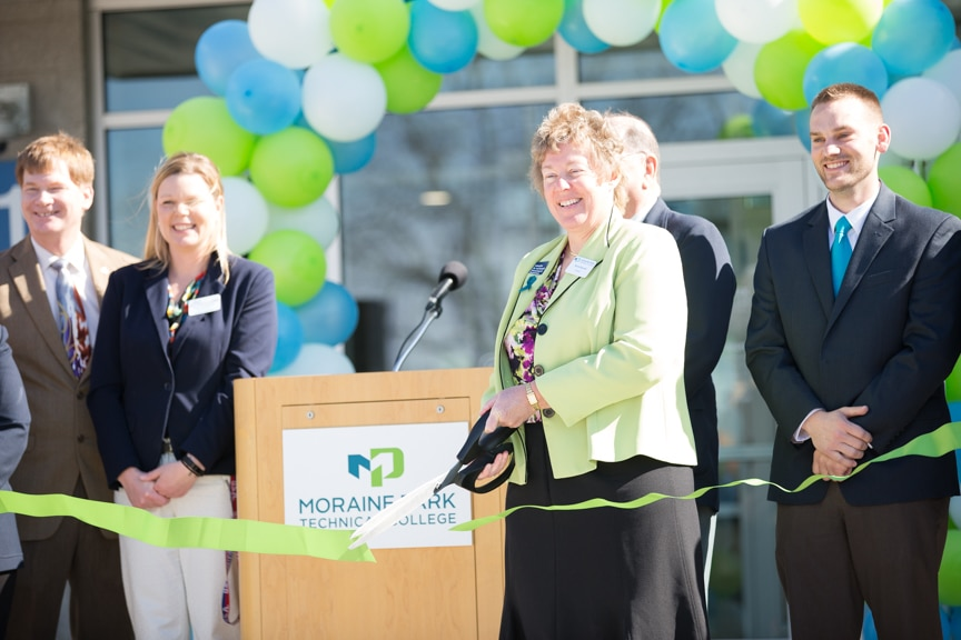Bonnie Baerwald cutting ribbon for new CEC entrance at Moraine Park Open House