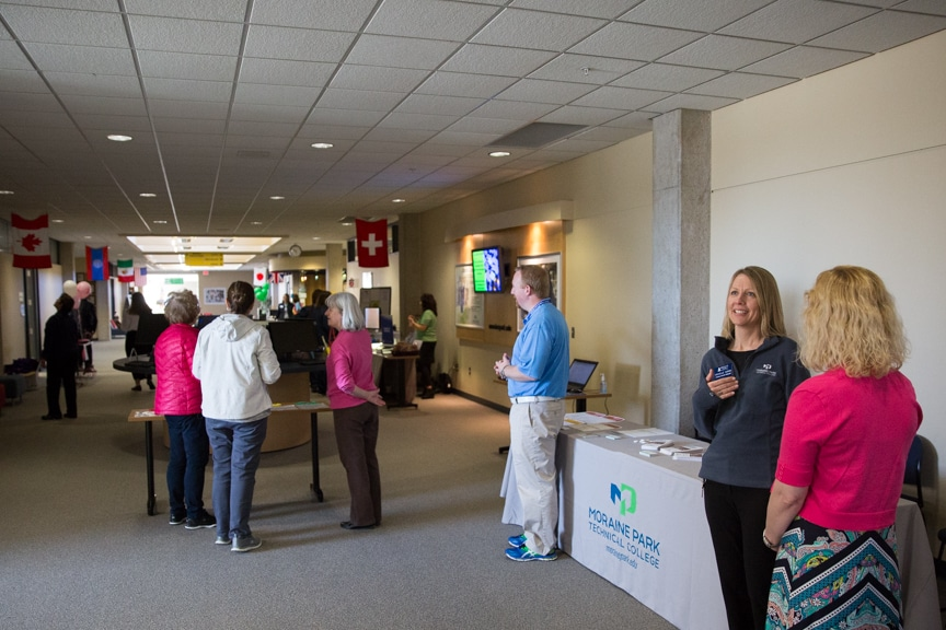 People walking on second floor at Moraine Park Open House
