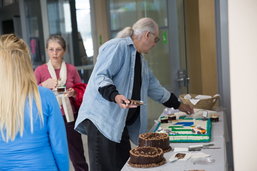 Man getting piece of cake at Moraine Park Open House