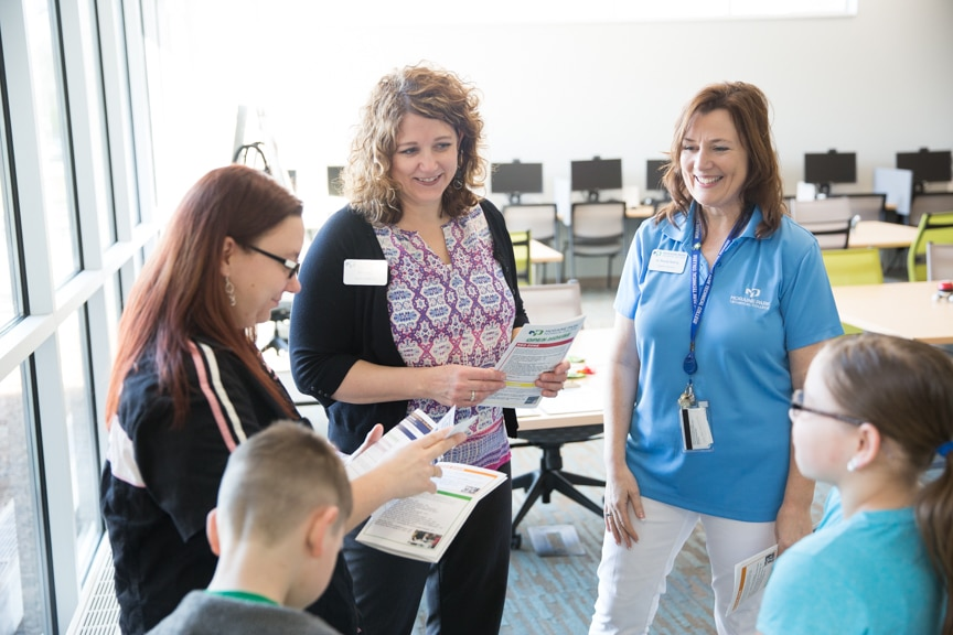 Public obtaining information from Career Center at Moraine Park Open House